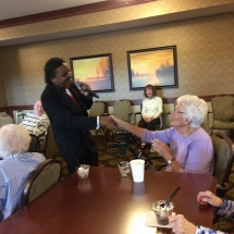Birthday Party-Lilydale Senior Living-Monroe Wright holding a tenants hand