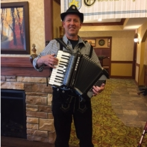 Oktoberfest Celebration-Lilydale Senior Living-cheerful accordion player