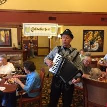 Oktoberfest Celebration-Lilydale Senior Living-tenants enjoying the food and accordion music