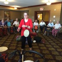 Drumming-Lilydale Senior Living-Cheri drumming for the tenants